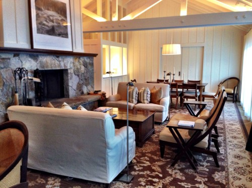 Estate lodge living space.. painting above the fireplace lifts to reveal a flat-screen TV!