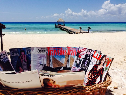 Basket of magazines by the beach.. a really nice touch!