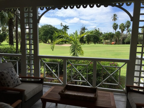 Another villa's patio overlooks the golf course